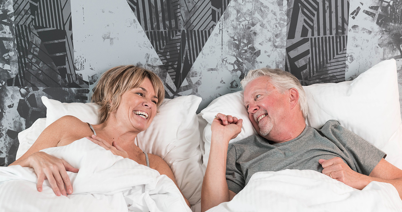 Happy couple after sleeping well