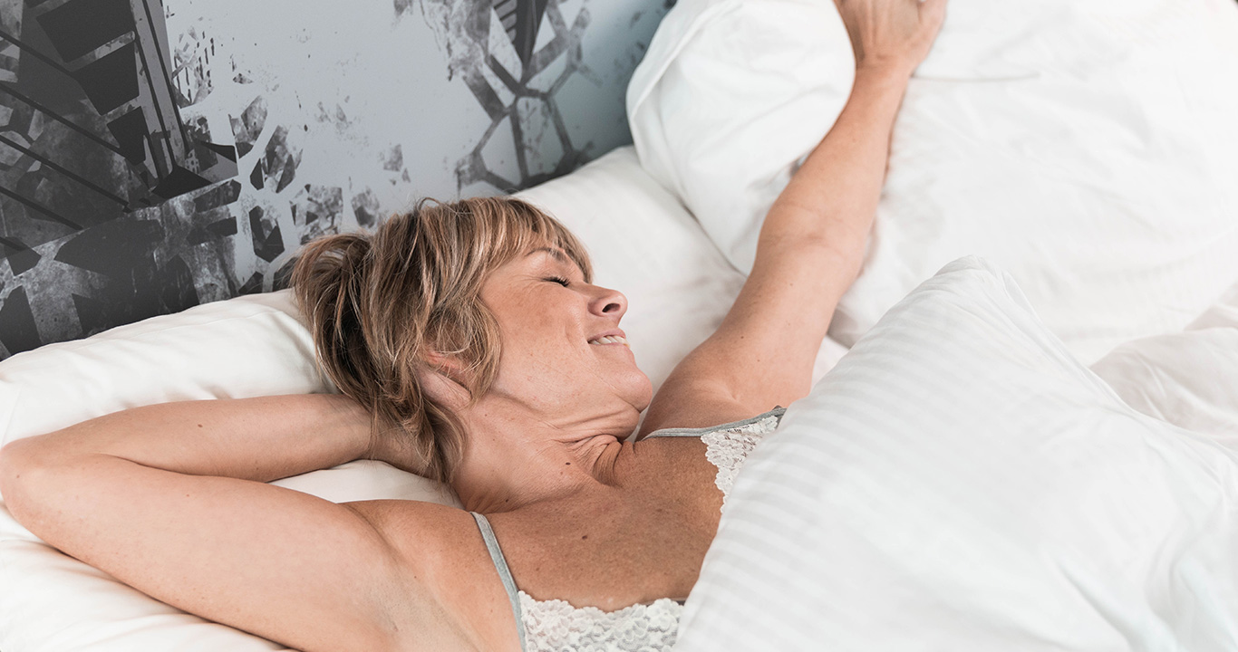 Woman waking up after a good nights sleep